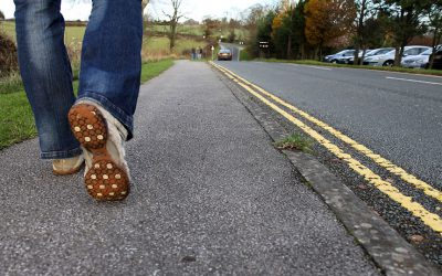 9052-close-up-of-feet-walking-on-a-road-pv