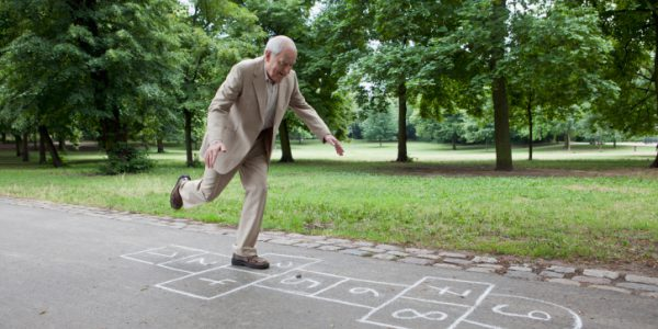 Senior man playing hopscotch in the park